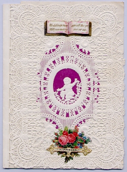 Valentine circa 1850. Paper lace, purple wafer paper and embossed flowers.
